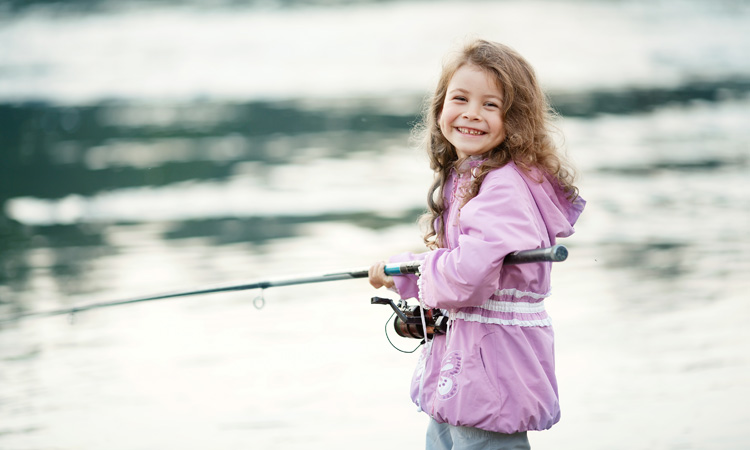 happy little child fishing